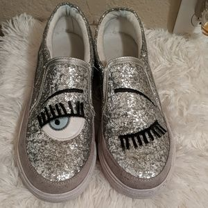 Silver glitter slip on winking sneakers
